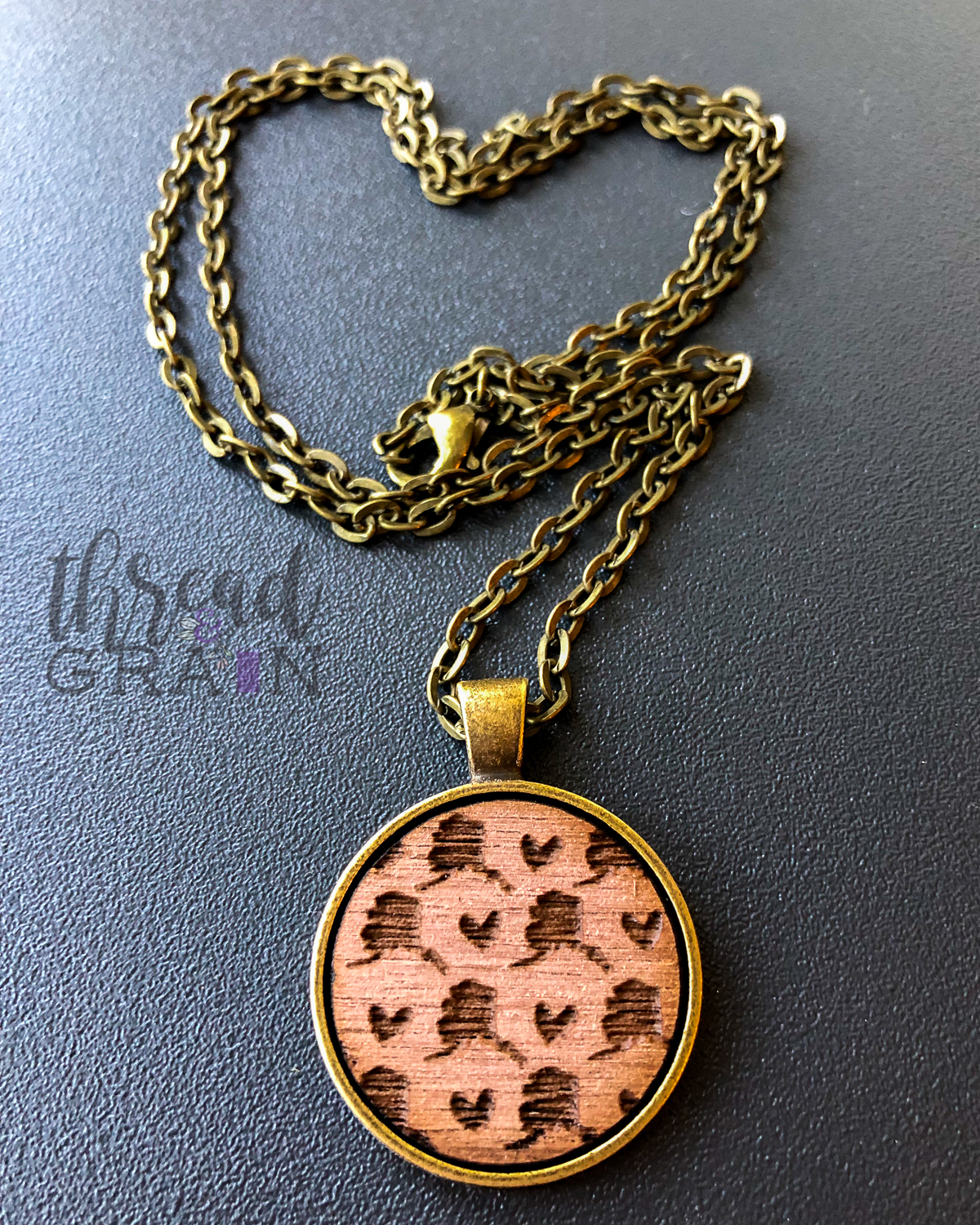 Alaska :: Laser Engraved, Wooden, Disc-Mounted NECKLACE